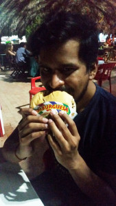 Manish enjoying burger