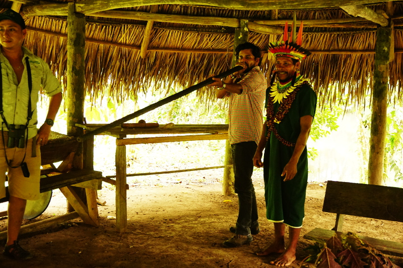 Firing a blowgun, Cuyabeno Reserve, Visit Amazon in Ecuador