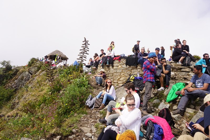 Crowd at Montana Machu Picchu waiting for clouds to clear, Peru